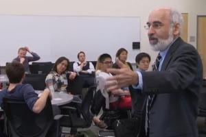 MIT professor and Climate Interactive team member John Sterman leads a group in a World Climate exercise